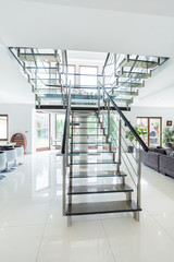 Glass stairs in modern house