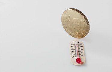 Fifty euro cent and thermometer