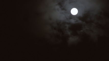 Full moon clouds fast