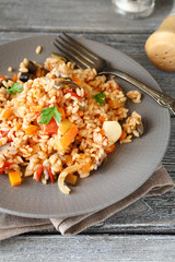 Tasty rice with vegetables on a plate