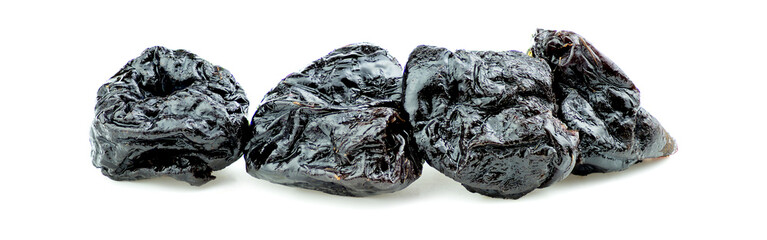 Pitted prunes isolated on white