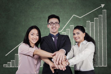 Business cooperation symbol with worker joined hands