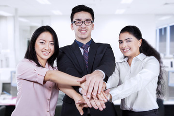Business team joining hands in the office
