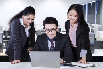 Caucasian businessman with two employees