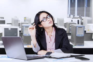 Chinese entrepreneur thinking in office
