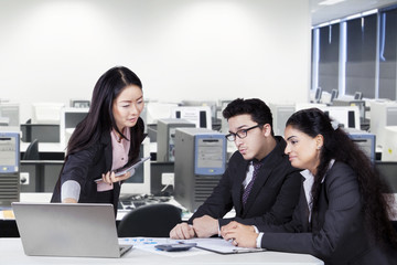 Chinese manager meeting with her team