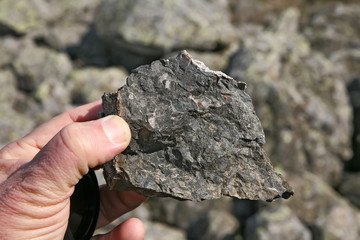 Basalt rock in the hand