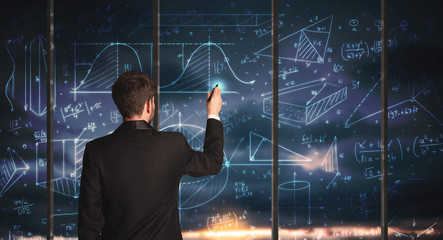 Businessman drawing business graphs