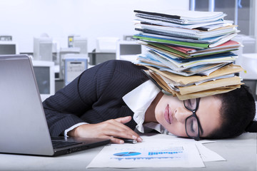Indian businesswoman sleeping in office