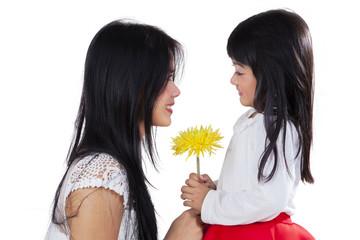 Lovely girl and mom holding flower
