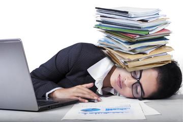 Overworked indian woman sleeping on desk