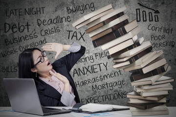 Woman with pressure and collapsing books