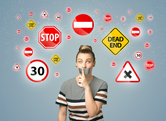 Young woman with glued mouth and traffic signals