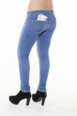 fit woman wearing jeans with some euros in the pocket