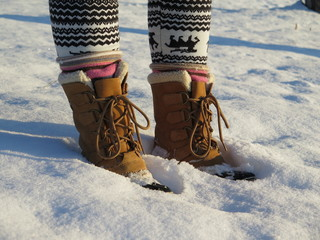 Winter boots in snow