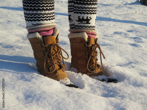 Winter boots in snow - 76192589