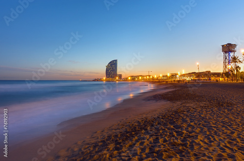 canvas print picture Beach in Barcelona at sunset