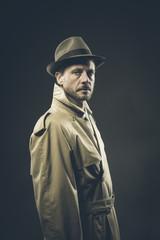 Confident agent in trench coat, film noir