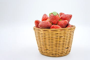 Strawberries in basket on white background