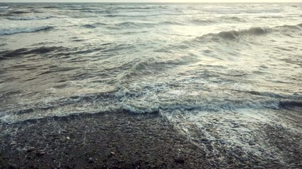 Slow motion waves breaking a shore