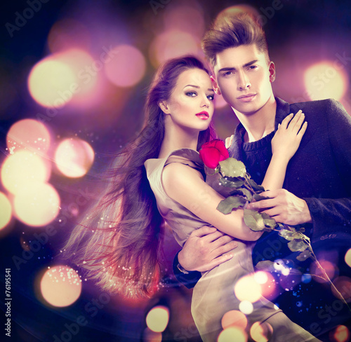 Valentine couple in love. Beauty girl with handsome model guy - 76195541