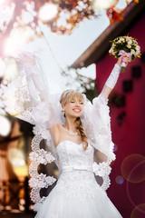 Portrait of a happy beautiful blonde bride