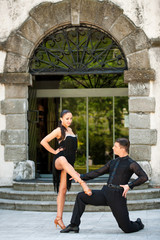 Beautiful young couple dancing outdoor in park