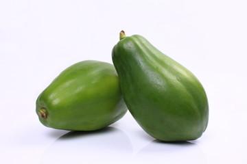 Green papaya on white background