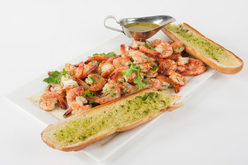 Plate with shrimps and garlic bread