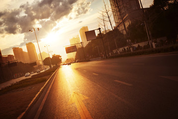 modern city road scene at sunset