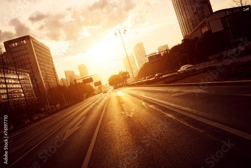 modern city road scene at sunset - 76197710