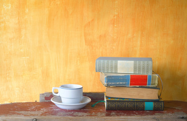 stack of books and a cup of coffee,free copy space
