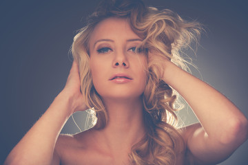 Beauty portrait of a pretty caucasian woman with blond hair over