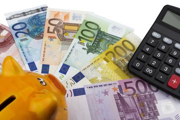 Piggy bank and Euros (EUR).
