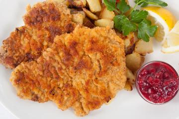 Wiener Schnitzel with potatoes and cranberry