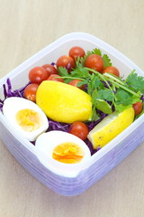 Mix vegetable salad and boil eggs in plastic lunch box