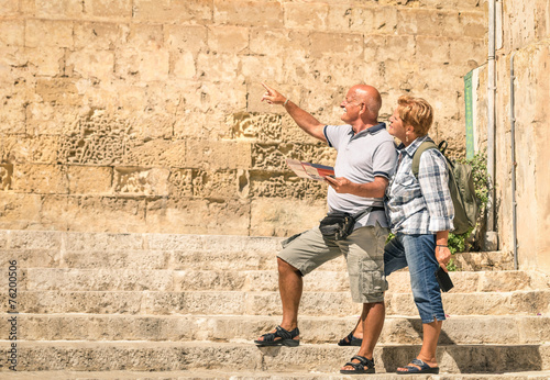 Leinwanddruck Bild Happy senior couple exploring old town of la Valletta