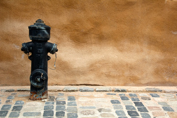 Wall With black Hydrant
