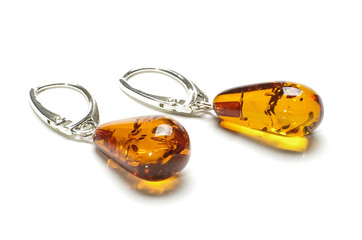 Pair of honey color amber droplet shape earrings isolated
