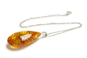 Amber pendant isolated on the white with clipping path