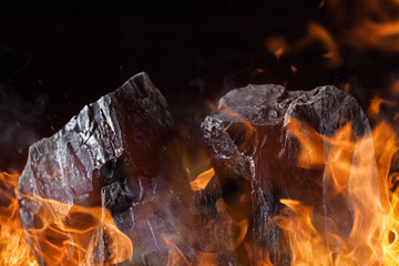 Coal lumps with fire flames