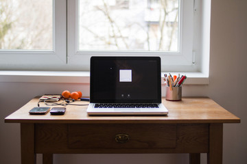 Computer on the wooden desk at home office