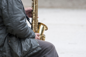 Street musician play the saxophone in the park
