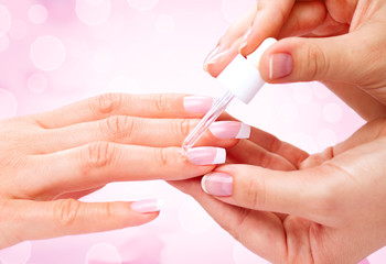 Manicure, hands spa cuticle oil. Beautiful woman hands closeup