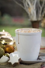 Cup of festive Christmas coffee with cookies