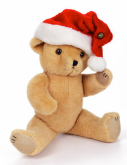 Teddy Bear with santa hat, isolated on white