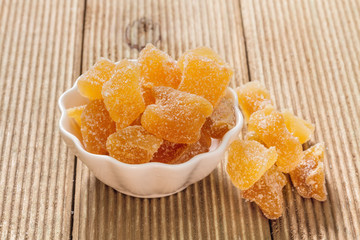 Candied ginger on a wooden table