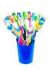 canvas print picture - Разноцветные зубные щетки в синем стакане