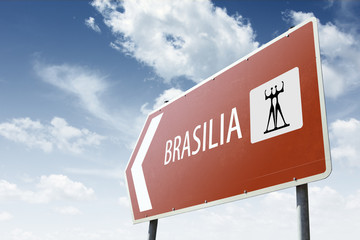 Brasilia direction. Brown road sign.
