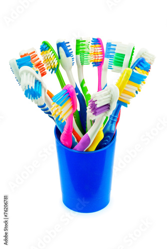 canvas print picture Разноцветные зубные щетки в синем стакане